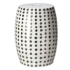 A hand-made stool with hand-painted black and white polka-dots.