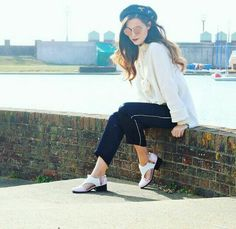 Marzia Bisognin | teashades | sunglasses | heels of her design | black beret | brick wall
