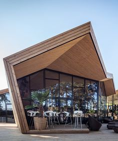metaform architects construct origami structure for luxembourg beach club