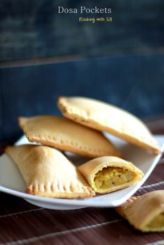 Dosa Pockets: For Crust: 1/2 cup Whole Wheat Flour 1/2 cup Plain Flour 1/2 tsp Baking Powder 2-3 tbsp Cold Butter, in cubes Salt, to taste Chilled Water, to knead dough For Stuffing: 1 Potato, boiled 2 tbsp Green Peas, boiled  2 tbsp Onions, finely chopped 2 tsp Chana Dal 1/2 tsp Mustard Seeds Salt, to taste 1 tbsp Oil