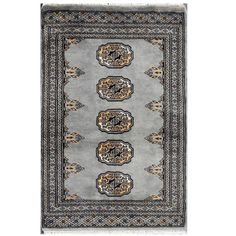 With a distinctive style, a gorgeous area rug from Pakistan will add some splendor to any decor. This Bokhara area rug is hand-knotted with a geometric pattern in shades of grey, black, tan, and ivory.
