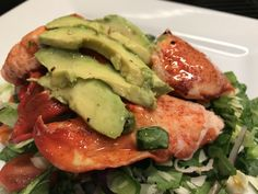 Fresh Lobster Claw on Salad of Baby Kale, Baby Spinach, Red, Green Pepper, Scallions, Red Onion, Grape Tomatoes, Avocado and Lemon Dressing