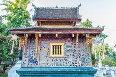 Mosaics telling stories in this style are on the walls of a temple in Laos. More photos are here.