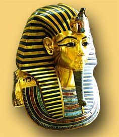 One of the masks from his sarcophagus,  gold with inlaid lapiz lazuli and other semi precious stones