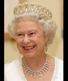 Queen Elizabeth wears the Grand Duchess Vladimir Tiara/http://www.express.co.uk/pictures/royal/3288/Royal-family-wearing-the-Papyrus-Lotus-Flower-Tiara-pictures/Queen-Elizabeth-Grand-Duchess-Vladimir-Tiara-85755