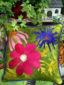 Wool Felt applique.  Saw in person at quilt show today and it was stunning.  There were 3 eye popping pillows that I hope to make for my bed.  WOW is all I can say.