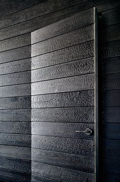 Traditional Japanese burning techniques were applied to the wood panels inside this house: http://www.dezeen.com/2015/11/16/aamodt-plumb-modern-texas-prefabricated-austin-house-blackened-wood-charred-cedar/ …
