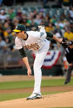 OAKLAND, CA - APRIL 06: Brandon McCarthy #32 of the Oakland Athletics pitches against the Seattle Mariners on Opening Day at O.co Coliseum on April 6, 2012 in Oakland, California. (Photo by Thearon W. Henderson/Getty Images)