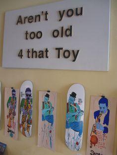 Steve Olson art hangs over Stereo skateboard decks and Tim Kerrs original art for the decks at Ranch-n-Roll
