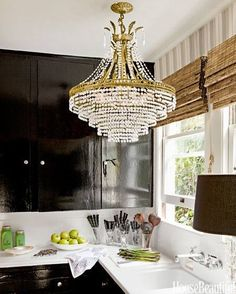 "A crystal chandelier and high-gloss kitchen cabinets painted Farrow & Ball's Pitch Black ""remind me of Paris apartments and grand French style,"" Tobin says. Read more: High Gloss Black Kitchen Cabinets - Modern Farmhouse Design - House Beautiful Black Gloss Kitchen, High Gloss Kitchen Cabinets, Black Cabinets, Kitchen Sink, Gold Kitchen, Diy Kitchen, Glossy Kitchen, Kitchen Pantry, Wood Cabinets"