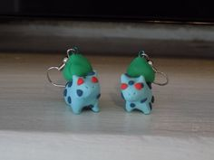 Hand sculpted earrings, based off of a grass type Pokemon, each Bulbasaur is unique and one of a kind. Please be kind to them if you decide to adopt them.
