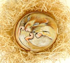 Dormouse painted on pebble