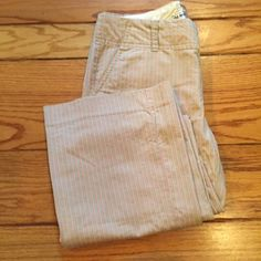 Old Navy Khaki and Pink Striped Pants Great condition! Old Navy pants, khaki with thin pink stripes! Size 4. 15% off 2+ bundles! Old Navy Pants