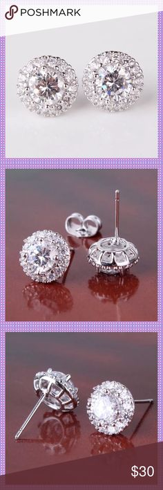 Swarovski Crystal Stud Earrings ⭐️⭐️STUNNING 18K White Gold Filled Swarovski Crystal Stud Earrings. Round Cut gems, surrounded by smaller Swarovski Crystals! These will get noticed! Absolutely breathtaking!⭐️⭐️COME GIFT BOXED⭐️⭐️ Boutique Jewelry Earrings