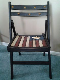 An old wooden folding chair that I painted with an Americana theme. It has rusty metal stars on the back and a barn star on the seat. It has a great weathered look.