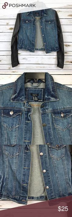 """Rue21 Black Faux Leather Sleeve Blue Denim Jacket In good condition, however black faux leathersleeves areslightly faded. Blue denim jacket overall with 5 center front buttons and two side functional pockets, with two chestfunctional flap buttoned pockets. Body is 72% cotton, 20% polyester, 8% viscose. Sleeves are 100% polyurethane. Acrossarmpit to armpit is 18.5"""" with jacket buttoned closed,length from high point shoulder to bottom hem is 19.5"""". ❌NO TRADES OR PAYPAL❌ Rue21 Jackets…"""