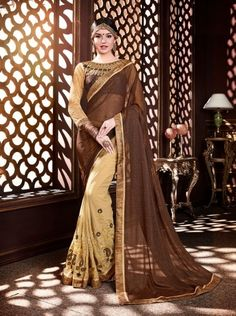 Price @1740.00 INR  Colour :  Beige & Brown Saree Fabric :  Georgette   Blouse Fabric : Fancy Blouse            Work :  Heavy Embroidry