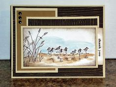 "By Heidi Weaver. Uses Stampin' Up ""Wetlands"" stamp set. Used water brush with ink on pad lid for sand and water. Sponged edges. Sanded dry-embossed background panels to bring out the wood grain."