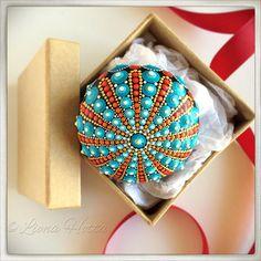 Mandala Stone sea urchin inspired red orange and blue.