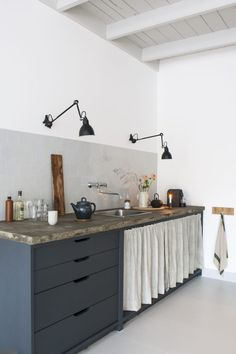 We love the versatility of the Lampe Gras lighting range, here being used as countertop lighting in a stylish urban kitchen.