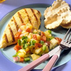 The fresh flavor of pineapple and the addition of garlic, cilantro and lime juice make a tropical salsa that's just the ticket for grilled chicken breasts.