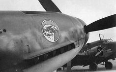 The unmistakable nose of a Bf 109F-1 and a Ju 52/3m in the background, parked at JG 51. Soviet Union, 1941.