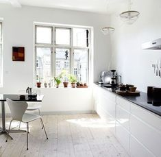 Modern  kitchen in white color without upper cabinets