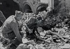 Monuments Officers Ernest De Wald and Roger Ellis sift through the rubble of the Abbey of Monte Cassino destroyed by Allied bombing in (National Archives World History, World War Ii, Monument Men, History Images, Historical Monuments, Army Life, National Archives, Lost Art, Flora
