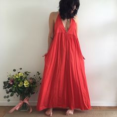 "Orange red lacausa ""Bouquet dress"" The Bouquet Dress is perfect for any Spring outing! It's made of lightweight cotton poppy, has a t-strap detail in back, and slight gathering under the bust. Drapes beautifully, and has a very flattering fit. Anthropologie Dresses Maxi"