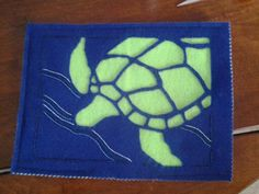 Felt cover for my Android Tablet. The right end allows the tablet to slide inand a small opening on the bottom allows it to plug in for charging while covered. The sea turtle is from a stain glass pattern. Hand embroidery stabilizes the turtle and creates the water design. Handmade by the owner of Tipsy Mermaid Art.