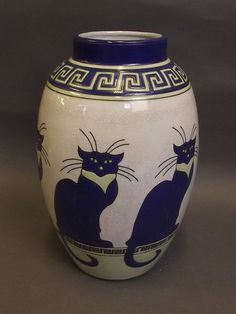Pottery vase with stylised decoration of a cat