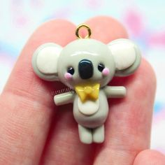 Hey guyssss! Here is a little koala i made inspired by @cjochhi her adorable koala amigurumi! Leave charm requests below please. ☺️ - { #Clay #polymerclay #polymer #jewelry #art #charm #arts_help #selfmade #miniature #paint #fimo #handmade #craft #handmadecraft #sculpture #kawaii #cute #fimoclay #sculpey #sculpeyclay #kawaiicharms #polymerclaycharms #crafting #crafter #pastel #premo #etsy #claydayshop #resin #claycharm }
