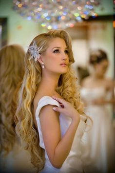 Bridal Hairstyle Long and thick wavy mane cut in long layers for a natural open hairstyle to display the length in style.