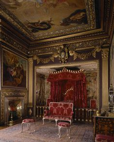 Powis Castle, Wales ~ View of the State Bedroom at Powis Castle showing the state bed, cipher, balustrade rail, ceiling and silvered gesso set of furniture c. 1725. The state bed is of partly gilded mahogany.