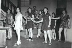 Sneakers were not yet prevalent in 1940, even for a game of tennis, and one piece gym suits were the norm. 1940 [ARM Image 11-1341.jpg]