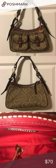 Dooney & Burke Handbag signature hearts Excellent condition.  Hardly used. Color is light olive green with brown leather trim, bucked and strap.  2 small front pockets and inside pocket. Dooney & Bourke Bags Shoulder Bags
