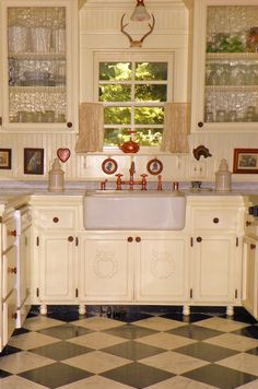 Cute Cottage Kitchen. The waved glass doored cabinets add charcter, as do the medallions on the lower cabinet doors.