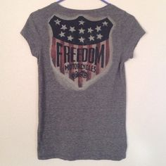 Lucky Brand Freedom Motorcycles t-shirt Super soft v-neck tee with a classic USA Freedom Motorcycles design on the back. Fabric is dark grey with red, yellow, green, and blue speckles. Shirt has been lightly worn but is in very good condition. Lucky Brand Tops Tees - Short Sleeve