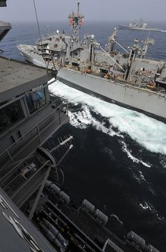 NORTH ARABIAN SEA (July 20, 2013) – The Military Sealift Command fast combat support ship USNS Rainier (T-AOE 7), near, transits alongside the aircraft carrier USS Nimitz (CVN 68), and the guided-missile cruiser USS Princeton (CG 59), in the distance, during a replenishment-at-sea.