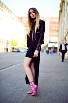 black dress with leather jacket and floor length cardigan