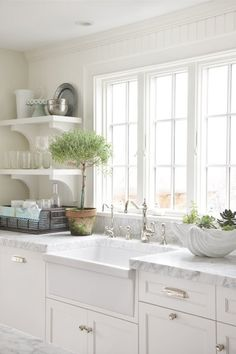 Molly Frey Design Lovely cottage kitchen design wth beadboard backsplash, white apron sink, white open shelves, white kitchen cabinets with marble counter top, French windows and polished nickel faucet. I like the open shelves! Classic Kitchen, New Kitchen, Kitchen Dining, Kitchen Decor, Kitchen Cabinets, White Cabinets, Kitchen White, Kitchen Shelves, Kitchen Windows