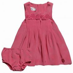 For the ultimate in luxury dressing for your little girl look no further than this splendid raspberry pink Dior dress and knickers set. Made in soft silk the dress has intricate pleats at the front and back, allowing the skirt to flare out nicely and lace roses decorate the bodice. The knickers are fully elasticated around the legs and waist for comfort.   100% silk