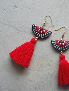 These are a hand-crafted pair of earrings that have been made from embroidered Hmong fabric, brass beads and colored yarns. They will be a perfect gift for the ethnic style lovers or for yourself to enjoy! Fabric Necklace, Diy Necklace, Diy Earrings, Earrings Handmade, Crochet Earrings, Tassel Earrings, Tassel Jewelry, Textile Jewelry, Fabric Jewelry