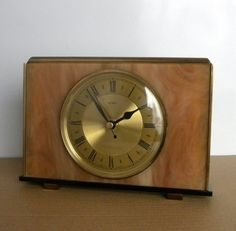 This is for one of these mantel shelf clocks surround from the 1970s era.    It was model 5947, made by Metamec in England. They are a pale brown marble look (solid plastic) surround which have been fitted with new modern battery movements.     The rim of the dial and parts of the stand are brass.  The hands are replacements to fit the new movements. There is a choice of simple hands or decorative hands