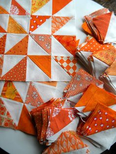 Orange/White Half Square Triangles from Sewkindawonderful ... And it is!  Love the color!