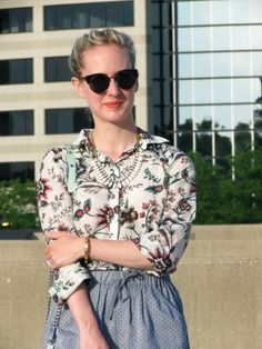 Subtle pattern mixing with a floral shirt & pin-dot skirt