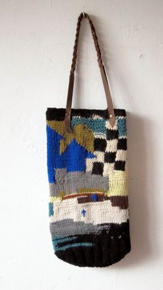 handmade knitted bag with leather handles