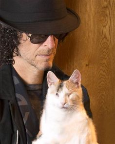 Howard Stern cuddles with his adopted cat, Bella, who is blind.  Awww.. He and his wife foster kitties