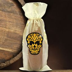 Sugar skull wine bottle gift bag/Day Of The Dead glitter skull bottle bag/Dia De Los Muertos glitter black and gold Aztec pattern candy skull imprinted on a drawstring sheer organza elegant gift bag. A festive holiday gift bag for wine and spirits, coffee syrups, cooking oils or candles.