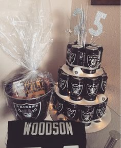 A creative gift idea for my boyfriend! He's a huge Raider fan so hopefully he loves his gift! The Raider ice bucket filled with gift cards and his favorite snacks party city NFL limited edition Raider Budweiser beer  Beer cake- string lights, raider beer pong balls, cut out numbers